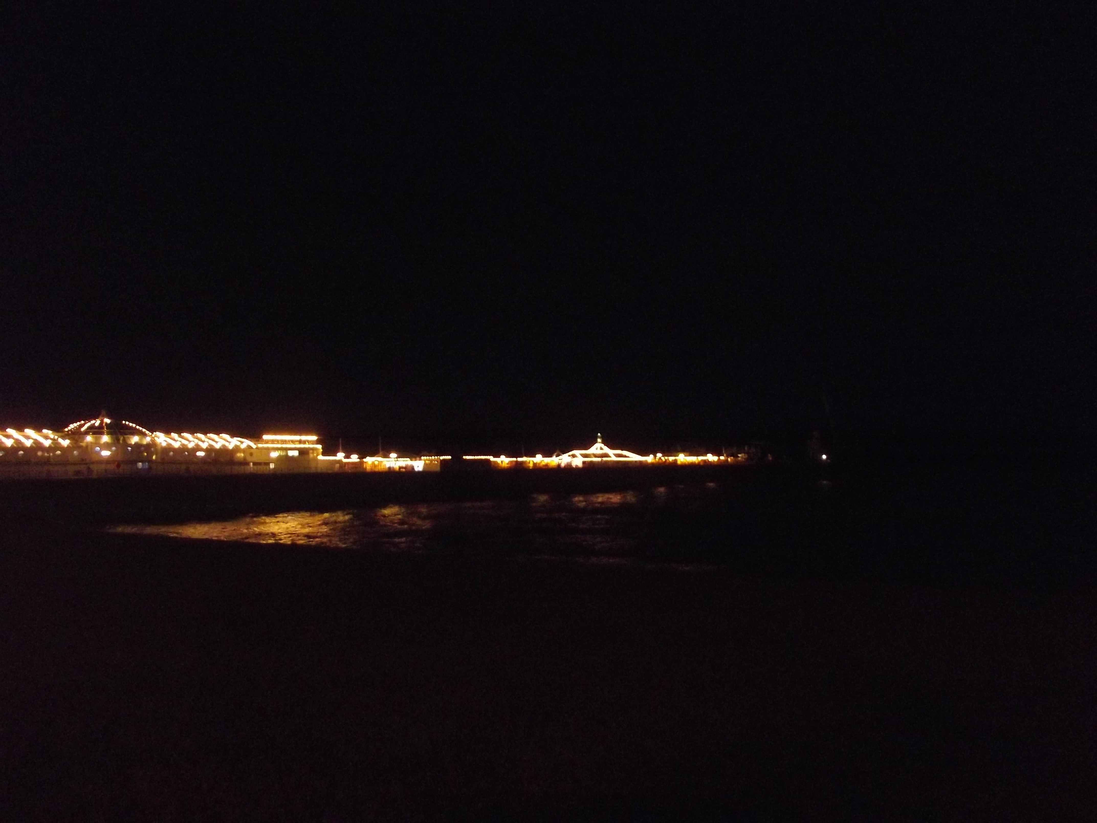 brighton peer at night