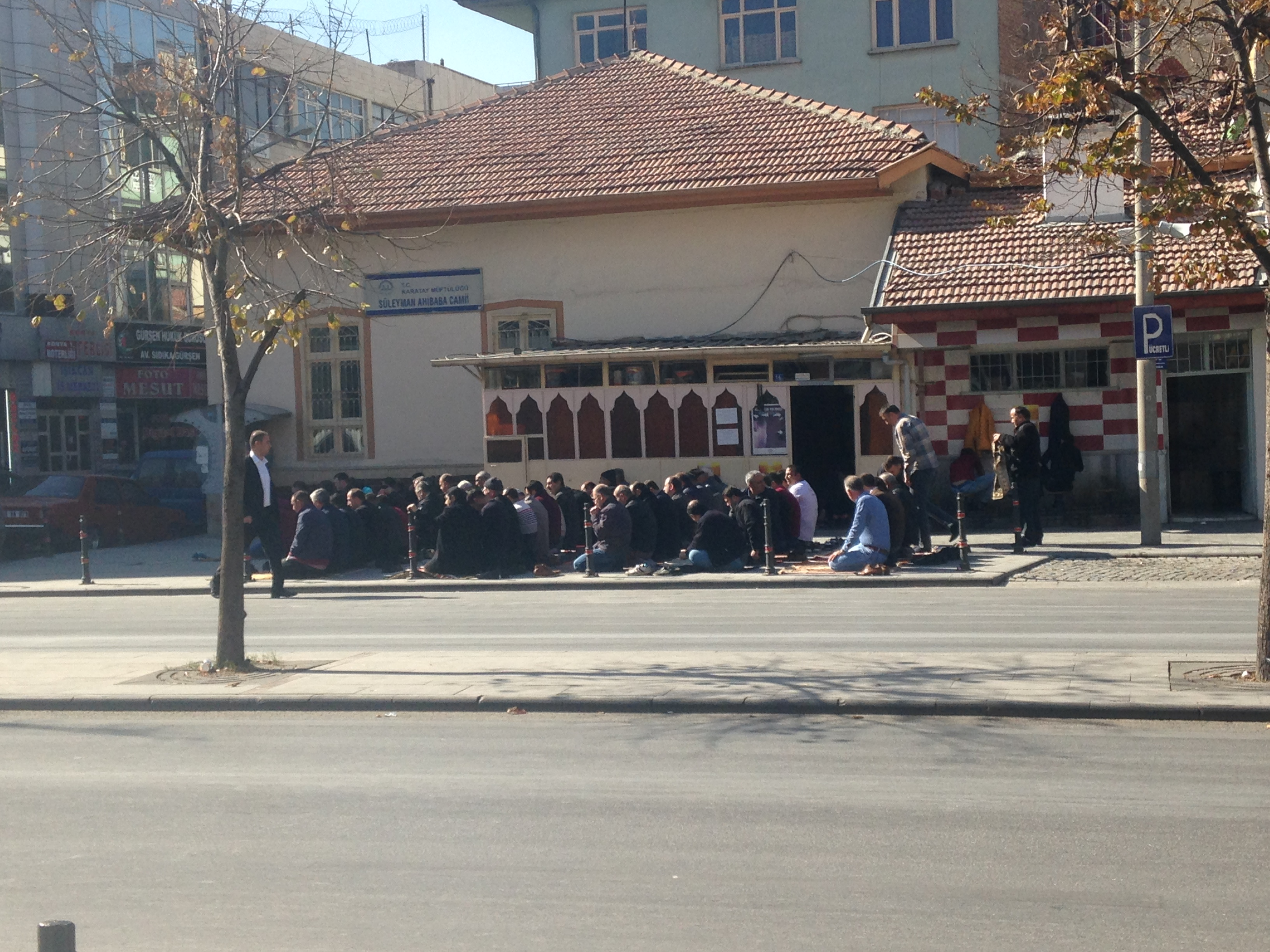 praying outside mosque in konya turkey